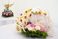 Flower arrangement for round table. Freshness atmosphere from flower arrangement in white background room Stock Photos
