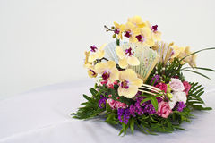 Flower arrangement for round table. Useful of orchid and another for flower arrangement on round table Royalty Free Stock Images