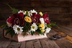 Flower arrangement rustic on wooden table. royalty free stock photography