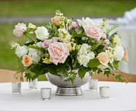 Flower arrangement in silver bowl. With pink and white roses Stock Images