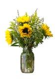 Flower arrangement with sunflowers. A flower arrangement with sunflowers and goldenrod Stock Images