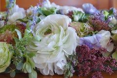 Flower arrangement. On a table Royalty Free Stock Photos