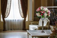 Flower arrangement table. Near coach Royalty Free Stock Image