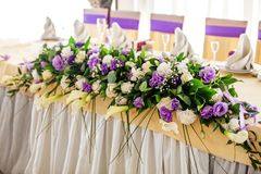 Flower arrangement on the table. Purple and white flowers. The c. Oncept of a party and wedding decor Stock Photo