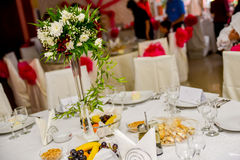 Flower arrangement on table Royalty Free Stock Image