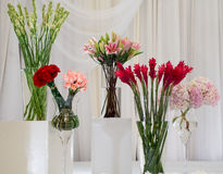 Flower arrangement at a wedding. Flower arrangement on a stage at a wedding reception Royalty Free Stock Photography