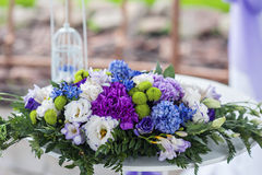 Flower arrangement at the wedding ceremony Stock Photos