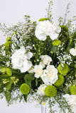 Flower arrangement with white carnations Royalty Free Stock Photos