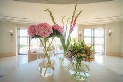 Flower arrangement in the foyer of a luxury villa. Flower arrangement in a white foyer of a luxury mediterranen villa royalty free stock images