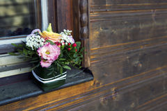 Flower arrangement on a windowsill Royalty Free Stock Images