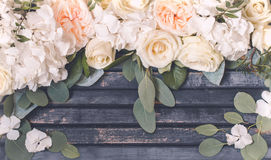 Flower arrangement on wooden background. Floral arrangement of beautiful white roses on wooden background ,concept flowers Royalty Free Stock Image