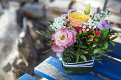 Flower arrangement on a wooden chair Stock Photo