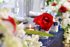 Flower Arrangements and Candles. Flower arrangements with candles ans red roses Stock Image