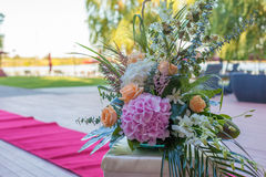 Flower arrangements. With orange roses and hydrangea and orchid Royalty Free Stock Photography