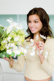 Flower Arranging. An attractive young woman flower arranging at home Royalty Free Stock Photo