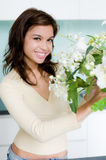 Flower Arranging. An attractive young woman flower arranging at home Royalty Free Stock Photography
