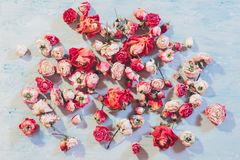 Flower arranging floral art assorted dried rose. Flower arranging. Floral art concept. Assorted dried roses on blue textured background stock photo