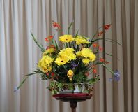 Flower Arrangment. A Beautiful Flower Arrangment on a Wooden Stand Stock Photo