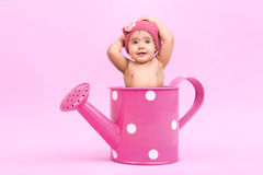 Flower baby. Beautiful baby inside a watering can all in pink Royalty Free Stock Photo