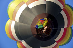 Flower Balloon. The view of a hot air balloon as it is directly over head in clear blue skies stock image