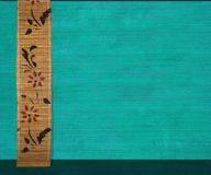 Flower bamboo banner on aquamarine ribbed wood Stock Image