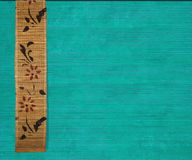 Flower bamboo banner on aquamarine wood. Flower bamboo banner on aquamarine ribbed wood background royalty free stock images