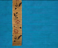 Flower bamboo banner on blue ribbed wood Royalty Free Stock Photos
