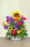 Flower basket with colorful autumnal flowers Royalty Free Stock Photography