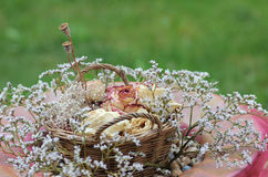 Flower basket with dried blossoms Stock Photos