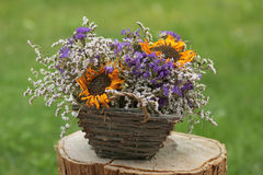 Flower basket with dried blossoms Royalty Free Stock Photography