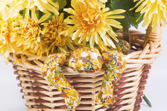 Flower basket with hand-made frog. Stock Photo