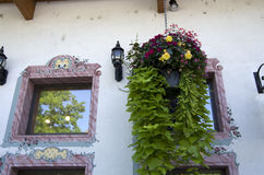 Flower basket by old house Stock Photo