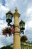 Flower basket on street lamp Royalty Free Stock Photo