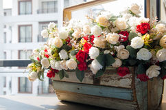 Flower basket  and urban view Royalty Free Stock Photos
