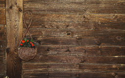 Flower basket. On a wall of a log house royalty free stock photography