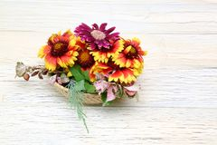 Flower basket in a wooden background Royalty Free Stock Photo