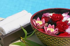 Flower bath. Thai style flower bath with towel on hotel pool Royalty Free Stock Images