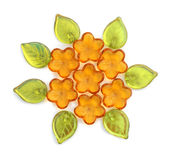 Flower beads. Glass beads in the shape of flowers and leaves. Isolated on white Royalty Free Stock Images