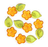 Flower beads. Glass beads in the shape of flowers and leaves. Isolated on white Royalty Free Stock Photography