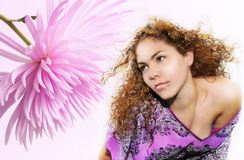 Flower beauty. Portrait of young beautiful blond woman with pink flower Royalty Free Stock Photos