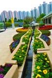Flower bed around crane sculpture Stock Image