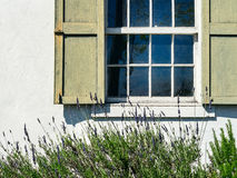 Shuttered window on a stucco wall Stock Photos
