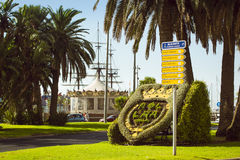 A flower bed with coat of arms on Plaza Puerta del Mar. ALICANTE, SPAIN - SEPTEMBER 9, 2014: A flower bed with coat of arms on Plaza Puerta del Mar in Alicante Stock Photos