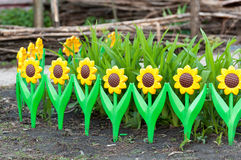 Flower bed with  decorative fence Royalty Free Stock Images