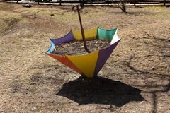 Flower bed in the form of an umbrella in the early spring. Royalty Free Stock Photos