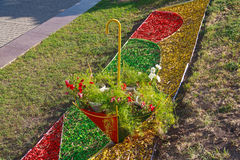 Flower bed in the form of an umbrella Stock Photos