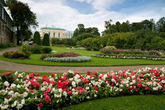 Flower bed in front of the palace park Stock Images