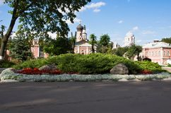 Flower bed next to the buildings of monastery Stock Photography