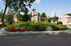 Flower bed next to the buildings of the old monastery Royalty Free Stock Photo
