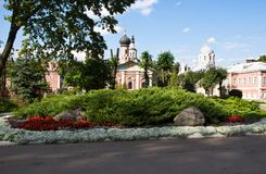 Flower bed next to the buildings of old monastery Royalty Free Stock Photography